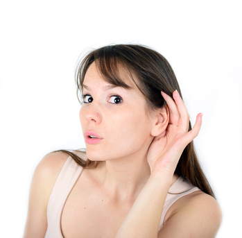 Beautiful female with listening gesture isolated over a white ba